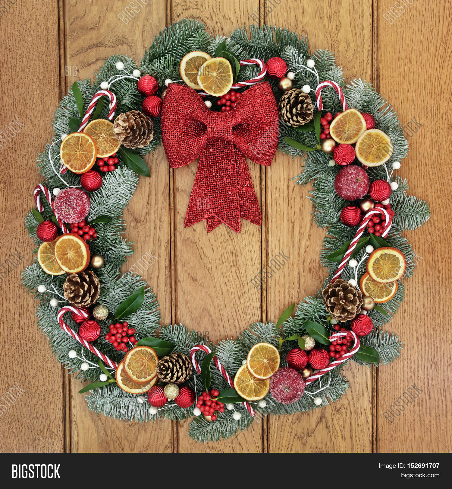 Fruit over the door christmas decoration - Christmas Wreath With Red Bow Decoration Dried Fruit Candy Canes Baubles Holly