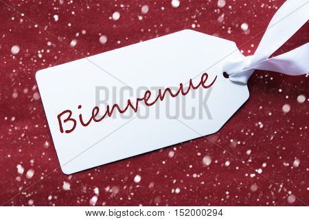 One White Label On A Red Textured Background. Tag With Ribbon And Snowflakes. French Text Bienvenue Means Welcome