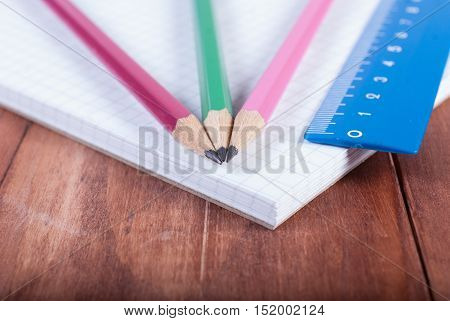 Notepad pencil and ruler. Back to school. Pencils and ruler on notebook. Focus on pencils