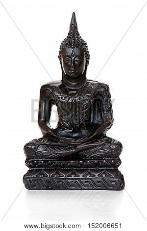 Traditional bronze Buddha statuette isolated on white background.