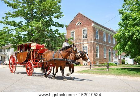 WILLIAMSBURG, VA, USA - MAY 7: Horse drawn carriage tours in British Colony on May 7th, 2012 in Williamsburg, Virginia, USA.