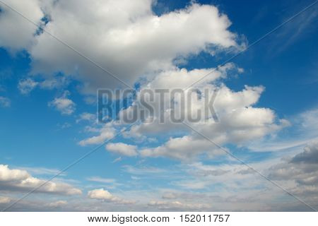 Cirrus clouds in the blue sky. Beautiful background.