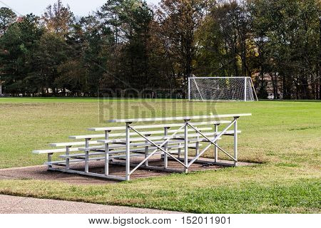 Soccer field with goal and stadium seating.