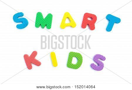 word of smart kids shaped by alphabet puzzles on white