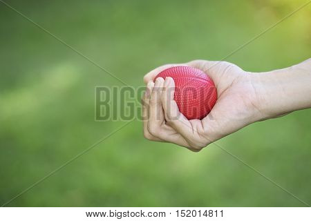 Woman hand squeezing a stress ball, close up