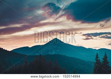 Majestic sunrise in montain landscape. Sunset time. Carpathian, Ukraine, Europe. Beauty world. Vintage filter