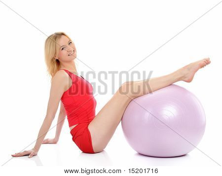 Pretty Sporty Fitness Woman Doing Exercise With Pilates Ball. Isolated Over White