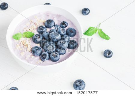 Healthy breakfast with yogurt muesli and blueberry