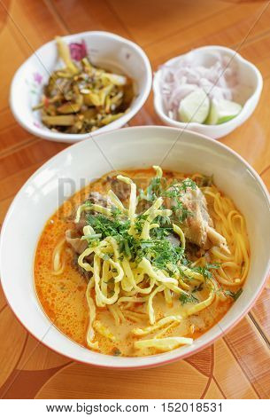 Curried Noodle Soup (Khao soi) with spicy coconut milk. Noodle Soup with beef. Curried noodle soup. Noodle Thai cuisine northern style. Khao Soi Recipe. Thai food.