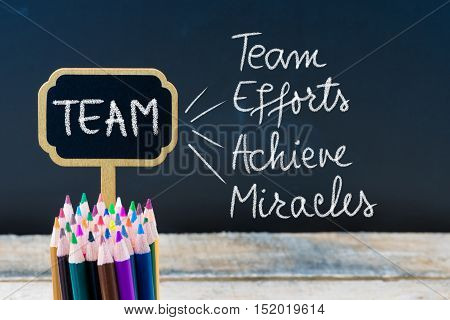 Business Acronym Team As Team Efforts Achieve Miracles Written With Chalk On Wooden Mini Blackboard