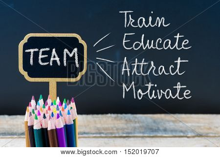 Business Acronym Team Train Educate Attract Motivate Written With Chalk On Wooden Mini Blackboard La
