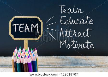 Business Acronym Team Train Educate Attract Motivate Written With Chalk On Wooden Mini Blackboard La