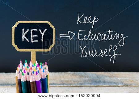 Business Acronym Key Keep Educating Yourself Written With Chalk On Wooden Mini Blackboard Labels