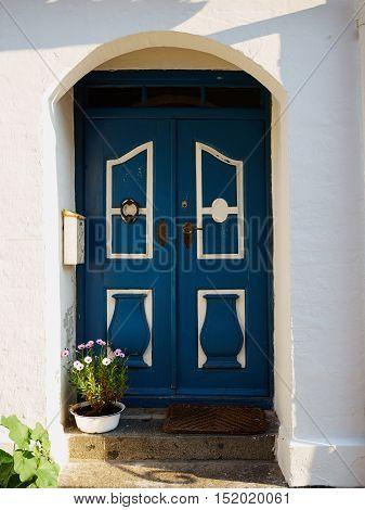 Traditional colorful craft vintage wooden blue front door Denmark