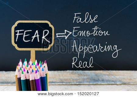 Business Acronym Fear False Emotion Appearing Real Written With Chalk On Wooden Mini Blackboard Labe
