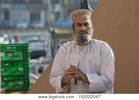 Nizwa Oman October 13th 2016: Old omani man in a goat market
