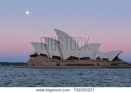 Sydney opera house  view with full moon at sunset in Sydney,Australia.Oct 17,2016 Sydney Opera House is famous arts center. Over 10 millions tourists visit Sydney a year.