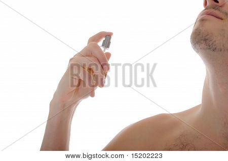 Handsome Young Male Spray Perfume On His Skin. Isolated On White Background