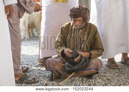 Nizwa Oman October 13th 2016: Omani man in Nizwa goat market