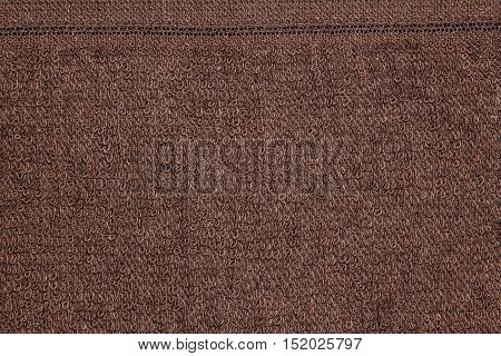 Closeup brown towel cloth and brown towel texture from towel beach for background and design with copy space for text or image.