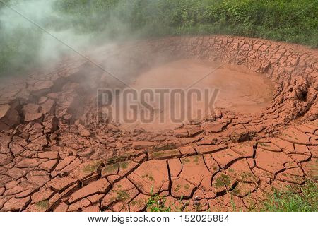 Krasnyy Red Mudpot in Valley of Geysers. Kronotsky Nature Reserve on Kamchatka Peninsula.