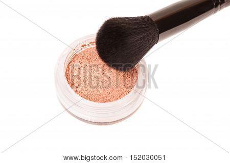 Powder blush and black makeup brush on white background