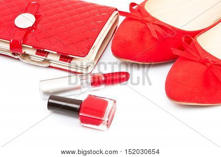 Purse shoes and cosmetics on a white background