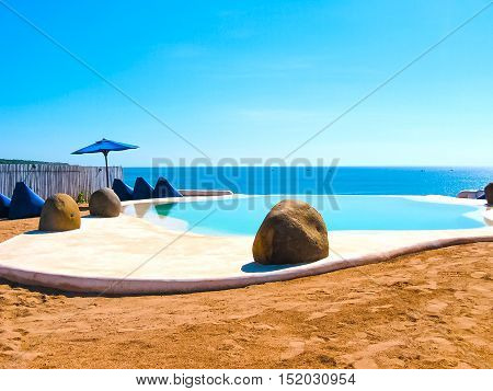 Pecatu, Bali, Indonesia - April 19, 2012: View of swimming pool at El Kabron Ibiza Style Beach Club