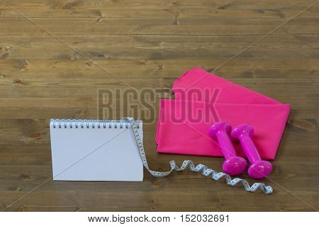 Pink set for the sport with a notebook