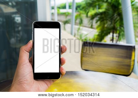 Close up of a man using smart phone with blank screen.Smart phone with blank screen and can be add your texts or others on smart phone.