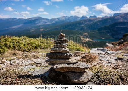 Stone pyramid marking hiking path in the mountains