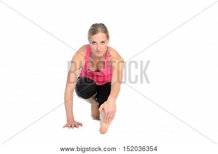 Woman Limbering Up Before A Workout