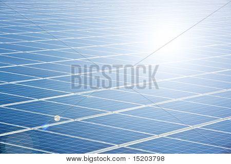 blue solar panel with sun reflection