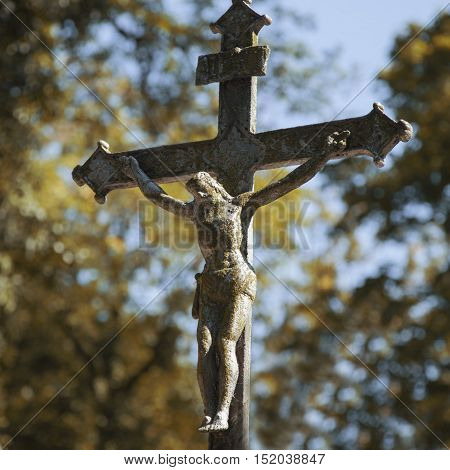 Antique statue of crucifixion of Jesus Christ (religion faith holy pain)