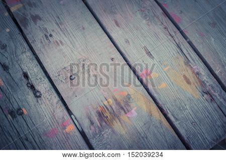 abstract wood background with streaks of color paint filter