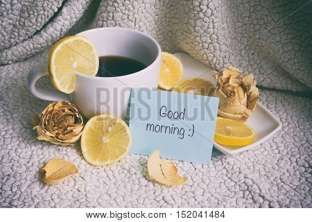 A cup of coffee white cup and saucer white fruit jelly on a plate, good morning