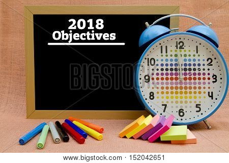 2018 New Year objectives written on a small blackboard.