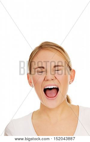 Stressed or angry young woman screaming