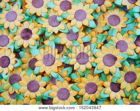 Artificial sunflower with green leaf floral background