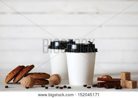 coffe paper cup and coffee bean on table
