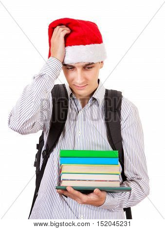 Pensive Teenager in Santa Hat with a Books on the White Background