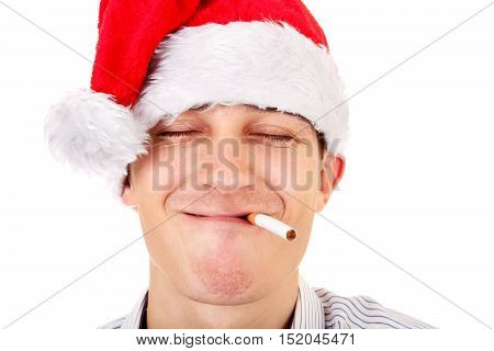 Satisfied Young Man in Santa Hat with Cigarette Isolated on the White Background