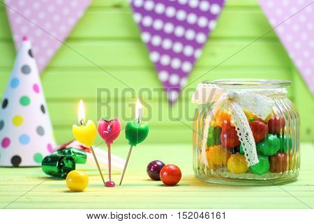 color candy in glass jar on holiday table