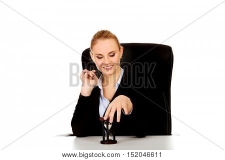 Young business woman holding a hourglass