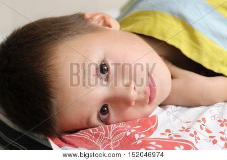 Little boy portrait preparing to sleep looking happy