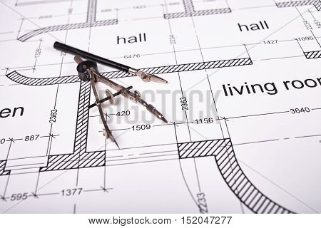 Construction of the building layout, building drawing on paper, a set of drawing tools