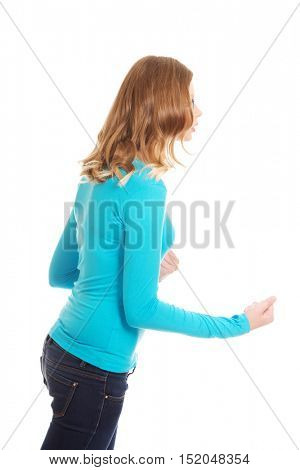 Angry teenage woman making fists