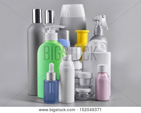 Set of body care products on grey background