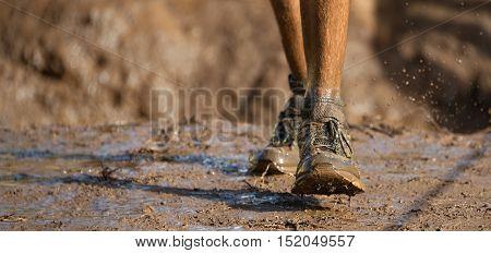 Mud race runners detail of the legs