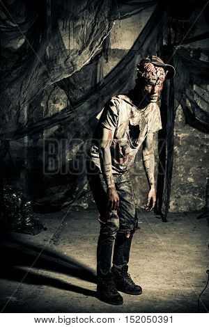 Terrible bloody zombie man  with the brains out in search of his victim. Horror. Halloween concept.